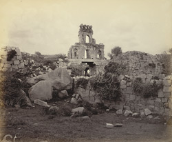 Ruins of Vijianuggur [Vijayanagara] near Humpee [Hampi]. Ruins of one of the old city gates
